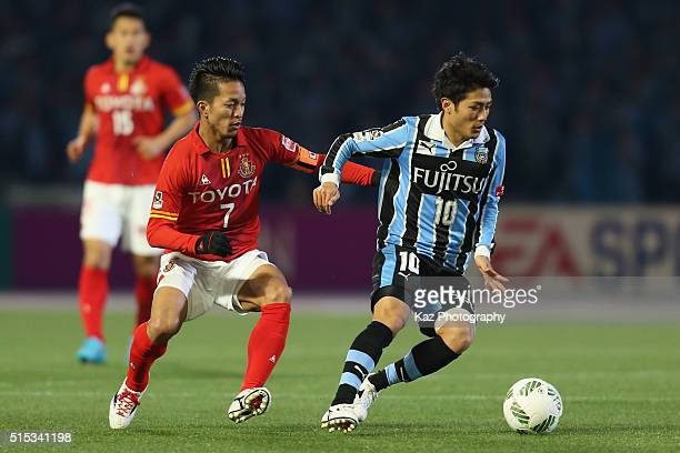 Ryota Oshima of Kawasaki Frontale and Taishi Taguchi of Nagoya Grampus compete for the ball during the JLeague match between Kawasaki Frontale and...
