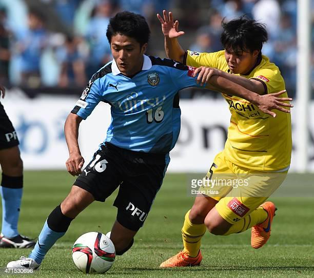 Ryota Oshima of Kawasaki Frontale and Yusuke Kobayashi of Kashiwa Reysol compete for the ball during the JLeague match between Kawasaki Frontale and...