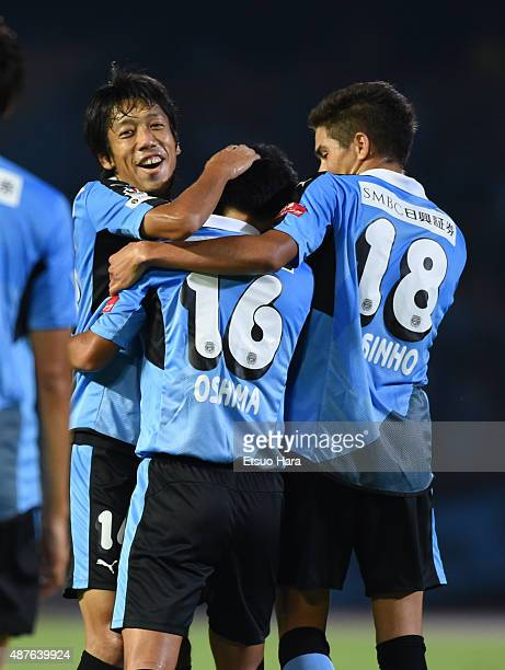 Ryota Oshima of Kawasaki Frontale is congratulated by his team mates after scoring his team's first goal during the Emperor's Cup second round match...