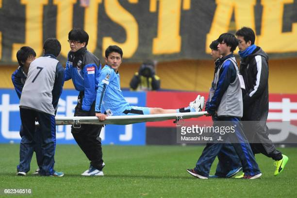 Ryota Oshima of Kawasaki Frontale is taken off by a stretcher during the JLeague J1 match between Vegalta Sendai and Kawasaki Frontale at Yurtec...