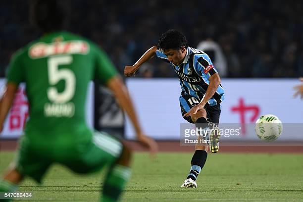 Ryota Oshima of Kawasaki Frontale scores his team's first goal during the JLeague match between Kawasaki Frontale and Albirex Niigata at the Todoroki...