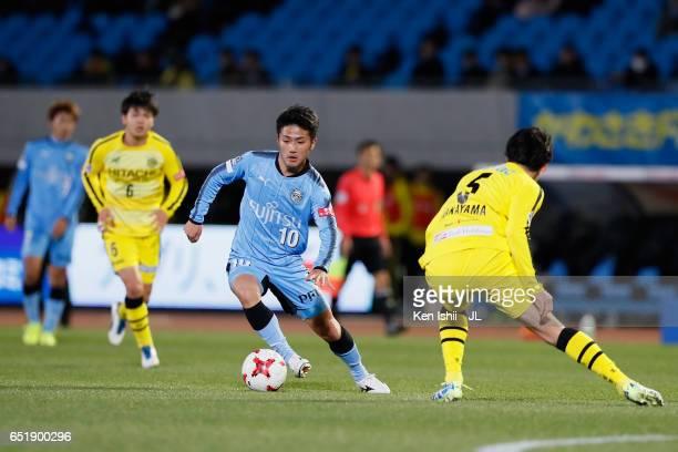 Ryota Oshima of Kawasaki Frontale takes on Yuta Nakayama of Kashiwa Reysol during the JLeague J1 match between Kawasaki Frontale and Kashiwa Reysol...