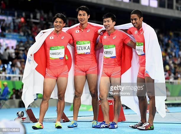 Ryota Yamagata Shota Iizuka Yoshihide Kiryu and Aska Cambridge of Japan celebrate after winning silver in the Men's 4 x 100m Relay Final on Day 14 of...