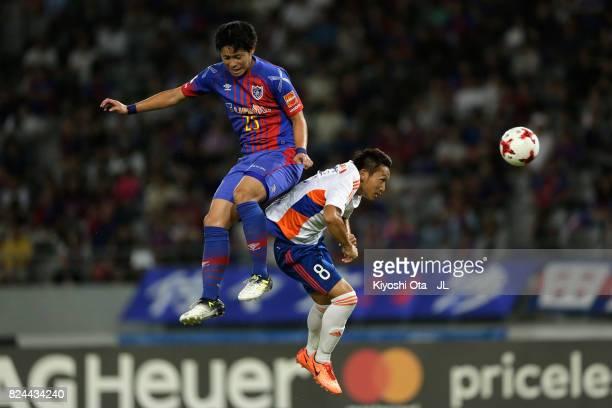 Ryoya Ogawa of FC Tokyo and Kei Koizumi of Albirex Niigata compete for the ball during the JLeague J1 match between FC Tokyo and Albirex Niigata at...