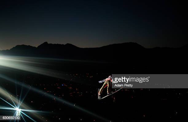Ryoyu Kobayashi of Japan soars through the air during his qualification jump on Day 1 of the 65th Four Hills Tournament ski jumping event on December...