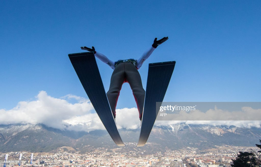 TOPSHOT - Ryoyu Kobayashi of Japan soars through the air during his second trial jump of the Four Hills competition (Vierschanzentournee) of the FIS Ski Jumping World Cup in Innsbruck on January 3, 2017. The third competition of the Four-Hills Ski jumping event takes place in Innsbruck before the tournament continues in Bischofshofen (Austria). / AFP PHOTO / APA / Jakob GRUBER / Austria OUT