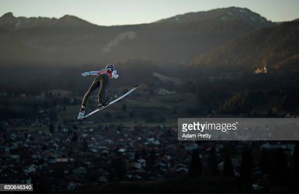 Ryoyu Kobayashi of Japan soars through the air during his training jump on Day 1 of the 65th Four Hills Tournament ski jumping event on December 29...