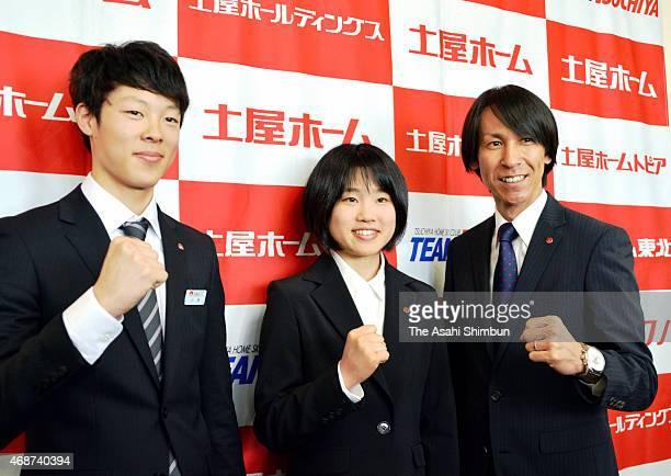 Ryoyu Kobayashi Yuki Ito and Noriaki Kasai pose for photographs during a press conference at Tsuchiya Home headquarters on April 3 2015 in Sapporo...