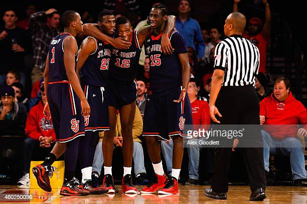 Rysheed Jordan Chris Obekpa and Sir'Dominic Pointer of the St John's Red Storm react to a foul in the second half during a game against the Gonzaga...