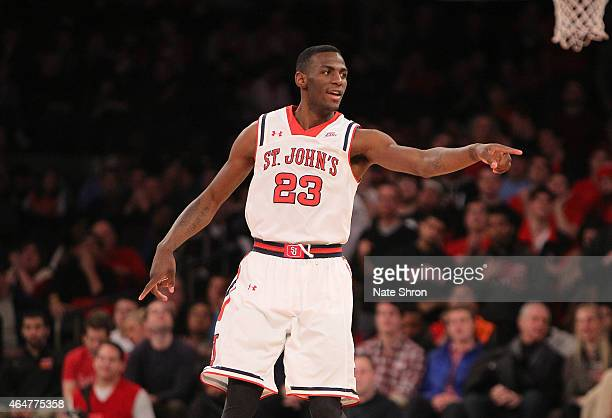 Rysheed Jordan of the St John's Red Storm cheers and points as he stands on the court during their win over the Georgetown Hoyas during the game at...