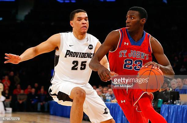Rysheed Jordan of the St John's Red Storm in action against Tyler Harris of the Providence Friars during the quarterfinals of the Big East Basketball...
