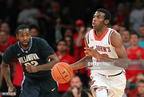 RySheed Jordan of the St John's Red Storm takes the ball down the court against JayVaughn Pinkston of the Villanova Wildcats during the game at...