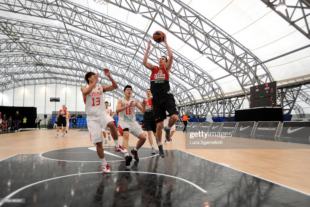 Rytis Pipiras (R) of Lietuvos Rytas Vilnius in action during the Nike International Junior Tournament game between Lietuvos Rytas Vilnius v Team China at London Soccerdome on May 10, 2013 in London, United Kingdom.