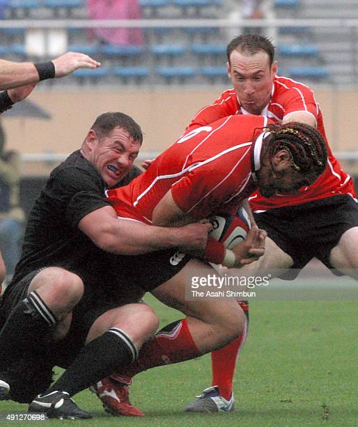 Ryu Koliniasi Holani of Japan is tackled by Angus MacDonald of Classic All Blacks during the rugby test match between Japan and Classic All Blacks at...