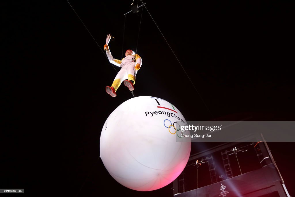 Ryu Seung-min, a member of Athletes Commission of the International Olympic Committee, is suspended in the air while carrying the Olympic torch to celebrate 100 days to go and the PyeongChang 2018 Winter Olympics torch during a torch relay on November 1, 2017 in Incheon, South Korea.