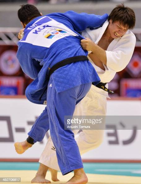 Ryu Shichinohe of Japan and SungMin Kim of Korea compete in the men's 100kg semifinal match during day three of the Judo Grand Slam at the on...