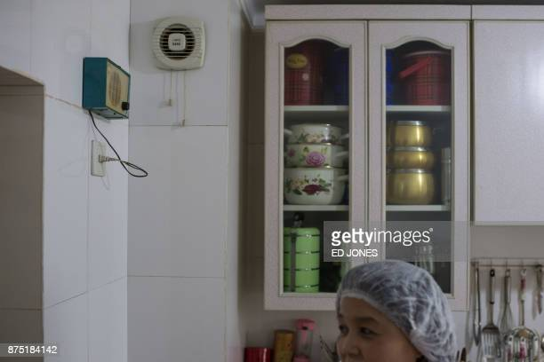 Ryu YangHui stands before a radio speaker common in all residences in Pyongyang and used for public announcements in an apartment in Pyongyang on...