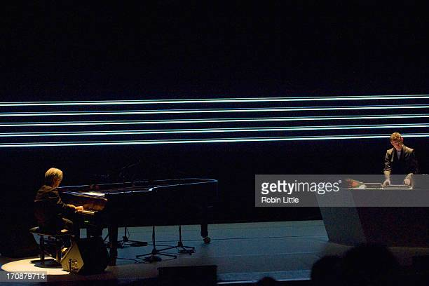 Ryuichi Sakamoto and Alva Noto perform on stage at the Royal Festival Hall on June 19 2013 in London England