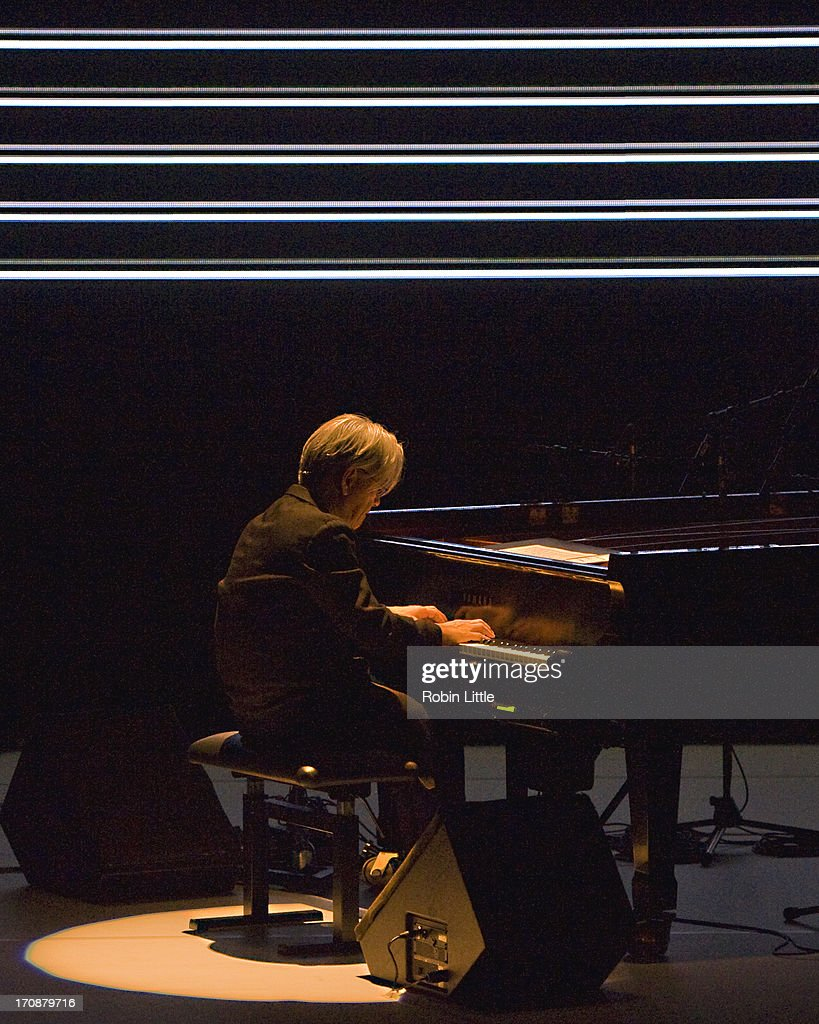 Ryuichi Sakamoto performs on stage at the Royal Festival Hall on June 19, 2013 in London, England.