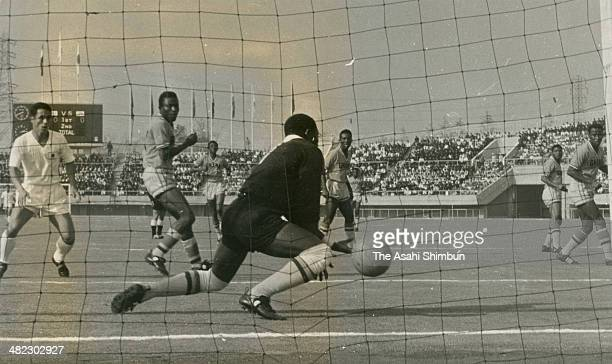 Ryuichi Sugiyama of Japan scores his team's first goal during the Tokyo Olympics Football Group D match between Japan and Ghana at Komazawa Stadium...