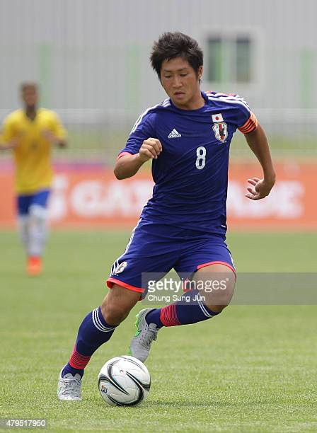 Ryuji Izuma of Japan in action during the Men's Football First Round Group C Match 9 between Japan and Brazil during the Universiade Gwangju 2015 at...