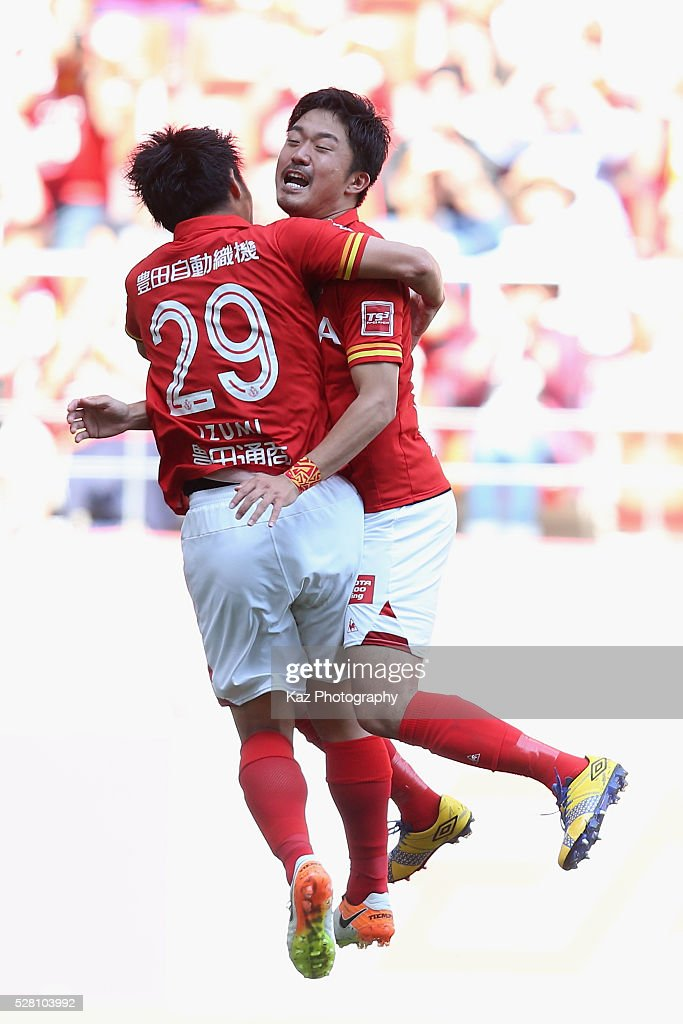 Ryuji Izumi (L) of Nagoya Grampus celebrates scoring his team's second goal with his team mate Shota Kobayashi (R) during the J.League match between Nagoya Grampus and Yokohama F.Marinos at the Toyota Stadium on May 4, 2016 in Toyota, Aichi, Japan.