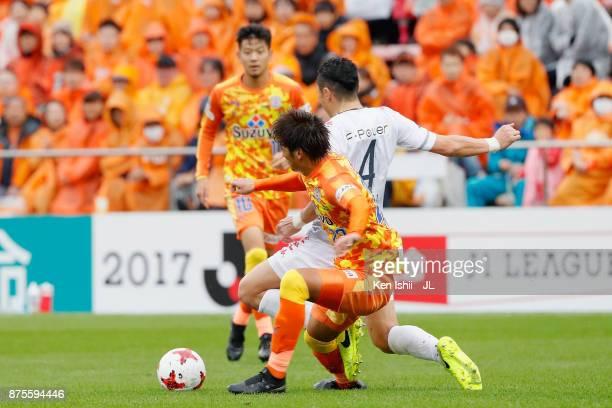 Ryuji Kawai of Consadole Sapporo and Koya Kitagawa of Shimizu SPulse compete for the ball during the JLeague J1 match between Shimizu SPulse and...