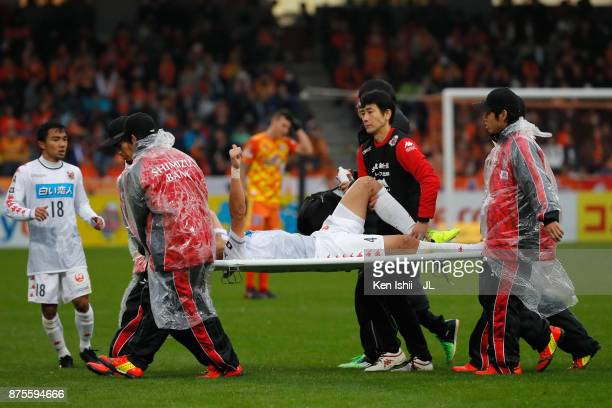 Ryuji Kawai of Consadole Sapporo is stretched off during the JLeague J1 match between Shimizu SPulse and Consadole Sapporo at IAI Stadium Nihondaira...