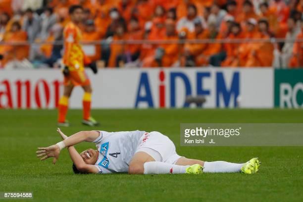 Ryuji Kawai of Consadole Sapporo lies injured during the JLeague J1 match between Shimizu SPulse and Consadole Sapporo at IAI Stadium Nihondaira on...