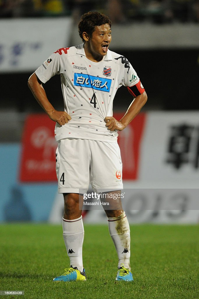 Ryuji Kawai #4 of Consadole Sapporo looks on during the J.League second division match between Tochigi SC and Consadole Sapporo at Tochigi Green Stadium on September 15, 2013 in Utsunomiya, Japan.