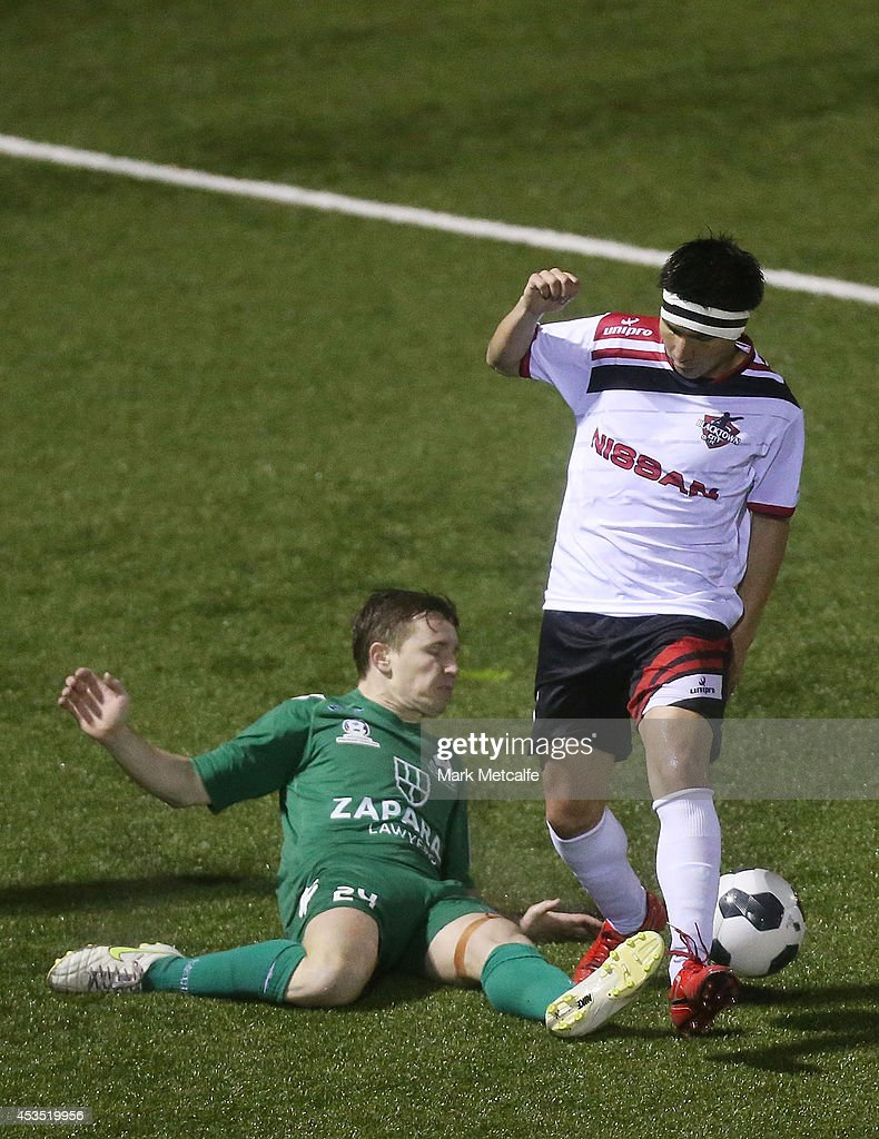 Ryuji Miyazawa of Blacktown City and Luke Pilkington of Bentleigh Greens compete for the ball during the FFA Cup match between Blacktown City and Bentleigh Greens at Lilys Football Centre on August 12, 2014 in Blacktown, Australia.