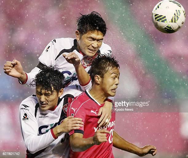 Ryuji Sawakami of Cerezo Osaka and Daiki Iwamasa of Fagiano Okayama vie for the ball during the second half of the JLeague promotion playoff final at...