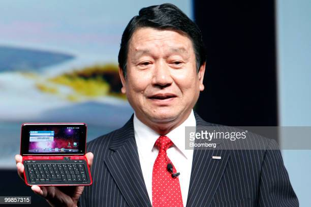 Ryuji Yamada president of NTT DoCoMo Inc holds the company's new LYNX SH10B smartphone running Google Inc's Android operating system manufactured by...