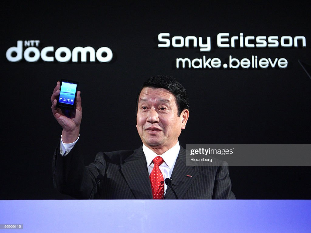 Ryuji Yamada president of NTT DoCoMo Inc holds up the Xperia smart phone during the launch held with Bert Nordberg president and chief executive...