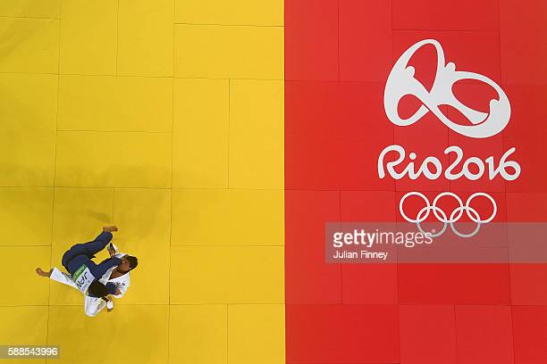 Ryunosuke Haga of Japan competes with Beka Gviniashvili of Georgia during the men's 100kg repechage judo contest on Day 6 of the 2016 Rio Olympics at...