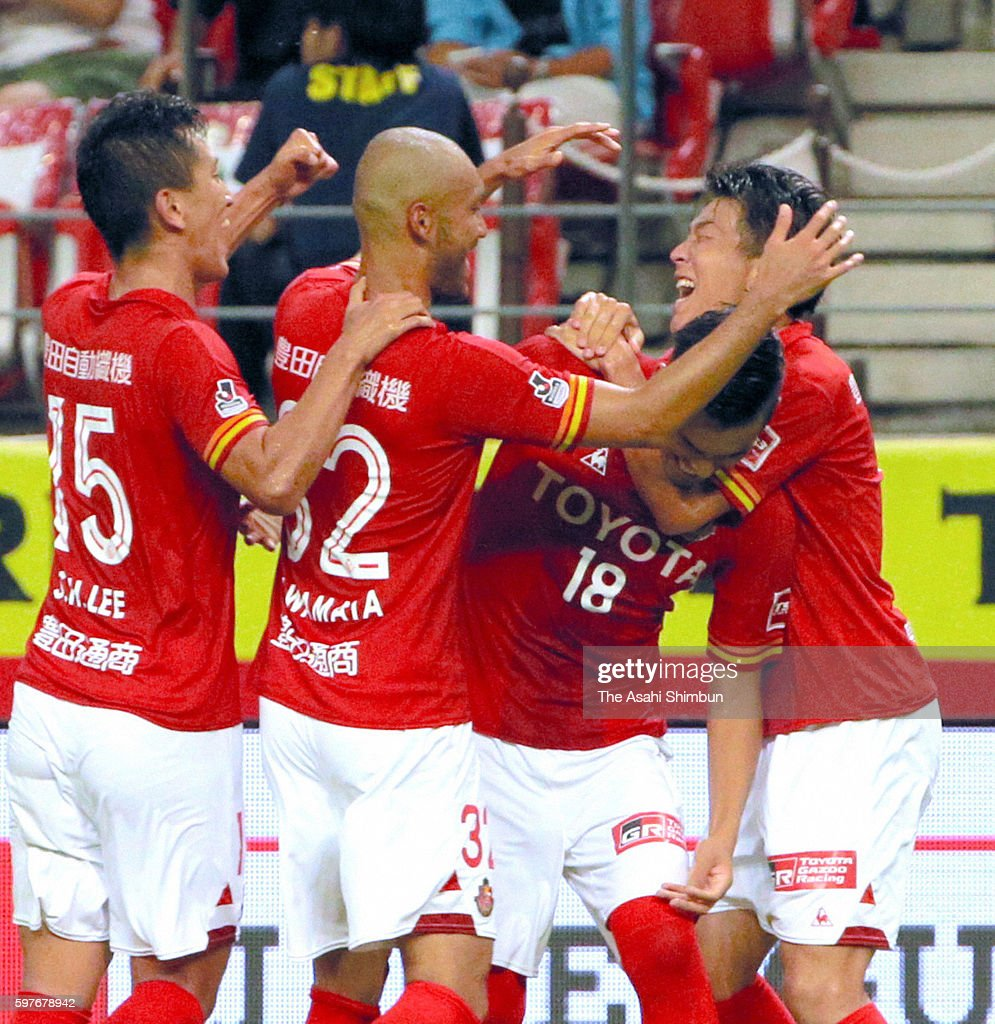 Ryunosuke Noda of Nagoya Grampus celebrate scoring his team's first goal with his team mates during the JLeague match between Nagoya Grampus and FC...
