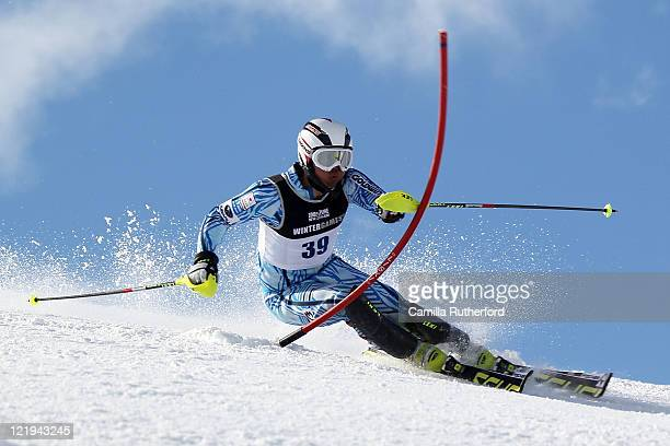 Ryunosuke Ohkoshi of Japan competes in the Mens Slalom run two during day 12 of the Winter Games NZ at Coronet Peak on August 24 2011 in Queenstown...
