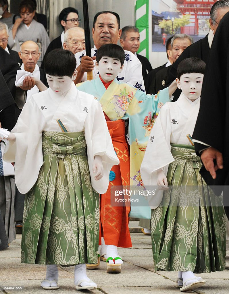 Ryushin Kumeda (C), 11, attends the 'Osendo no Gi' ritual to pray for success at the start of the one-month Gion Festival at Yasaka Shrine in Kyoto on July 1, 2016. Kumeda will lead the parade of decorated floats, or Yamahoko procession, on July 17.