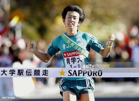 Ryusuke Sadanaga of Aoyama Gakuin University crosses the finish line in Hakone Kanagawa Prefecture on Jan 2 as the university won the first half of...