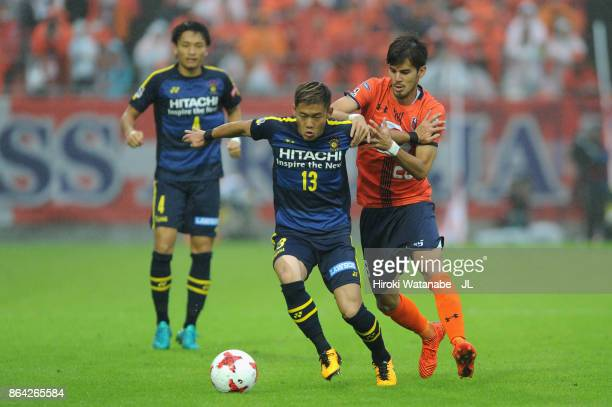 Ryuta Koike of Kashiwa Reysol and Ariajasuru Hasegawa of Omiya Ardija compete for the ball during the JLeague J1 match between Omiya Ardija and...