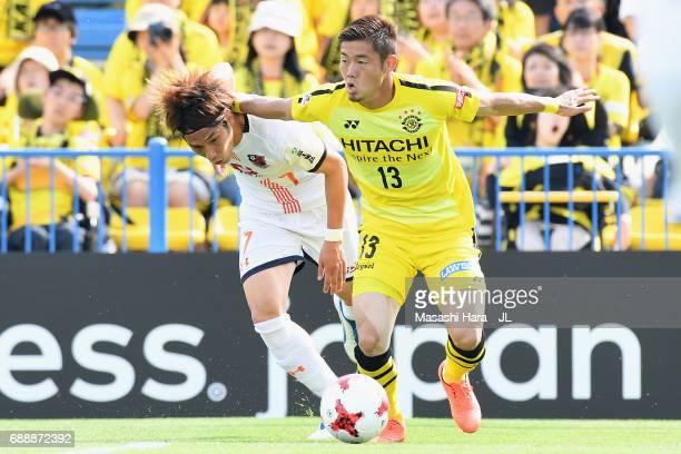 Ryuta Koike of Kashiwa Reysol and Ataru Esaka of Omiya Ardija compete for the ball during the JLeague J1 match between Kashiwa Reysol and Omiya...