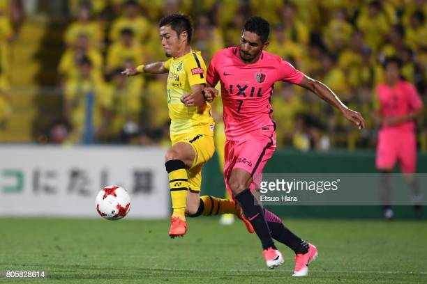 Ryuta Koike of Kashiwa Reysol and Pedro Junior of Kashima Antlers compete for the ball during the JLeague J1 match between Kashiwa Reysol and Kashima...