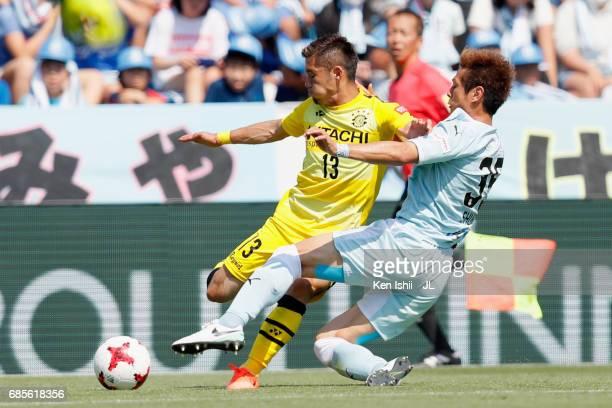 Ryuta Koike of Kashiwa Reysol is tackleed by Shun Morishita of Jubilo Iwata during the JLeague J1 match between Jubilo Iwata and Kashiwa Reysol at...