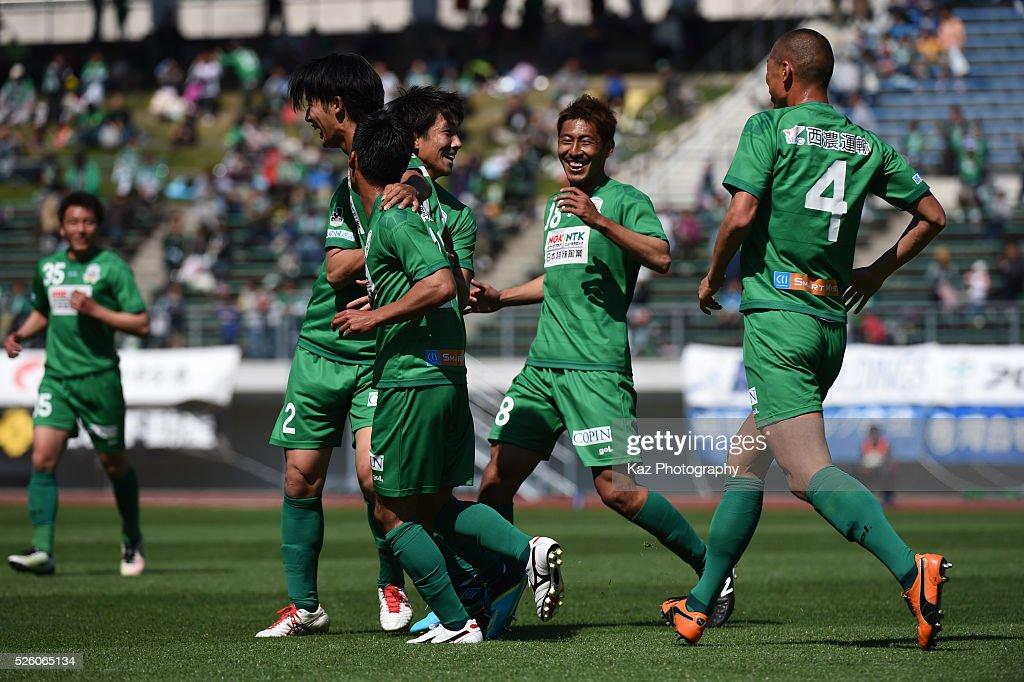 Ryutaro Karube of FC Gifu celebrates the opener with Mananori Abe and Yuto Ono of FC Gifu during the J.League match between FC Gifu and Renofa Yamaguchi at the Nagaragawa Stadium on April 29, 2016 in Nagoya, Japan.
