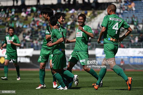 Ryutaro Karube of FC Gifu celebrates the opener with Mananori Abe and Yuto Ono of FC Gifu during the JLeague match between FC Gifu and Renofa...
