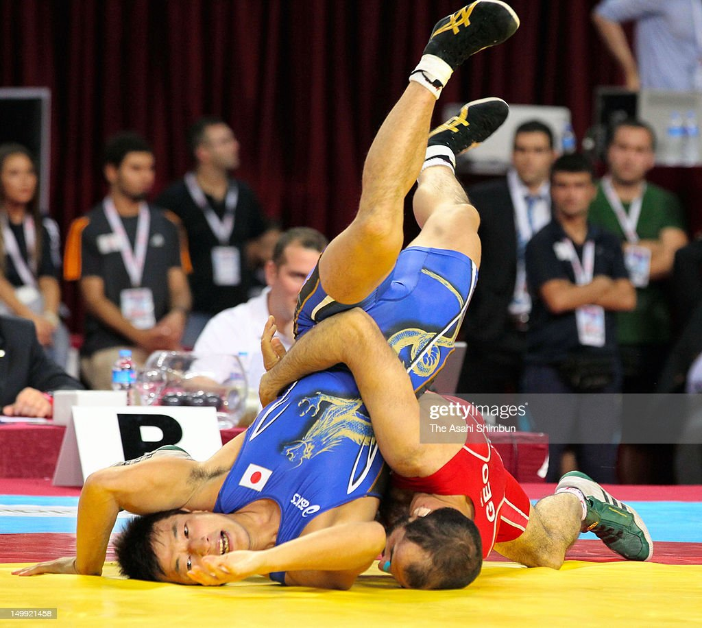 Ryutaro Matsumoto of Japan competes with Revaz Lashkhi of Georgia in the Men's 60kg GrecoRoman second round during day two of the 2011 FILA World...
