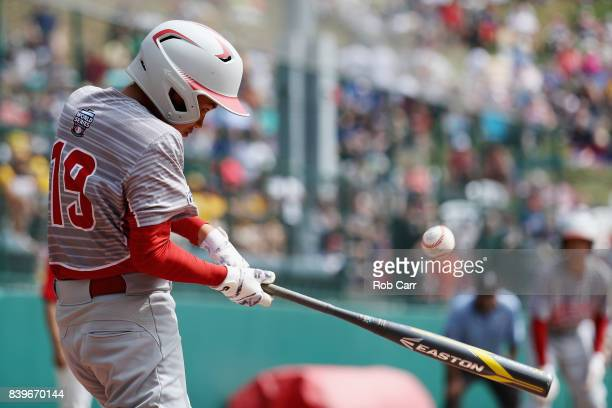 Ryuto Konno of Japan hits the ball against Mexico during the International Championship game of the Little League World Series at Lamade Stadium on...