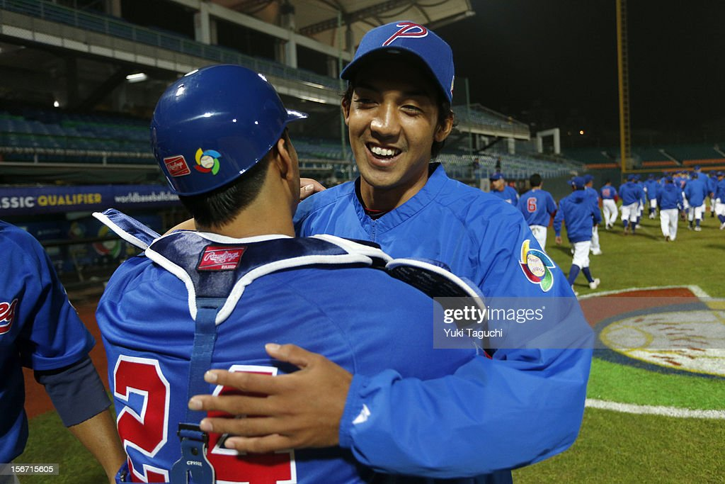 Ryuya Ogawa #25 and Chad Nacapoy #24 of Team Philippines hug after Game 5 of the 2013 World Baseball Classic Qualifier against Team New Zealand at Xinzhuang Stadium in New Taipei City, Taiwan on Saturday, November 17, 2012.