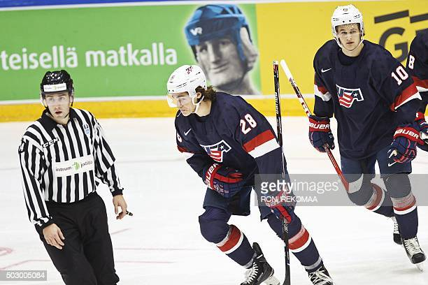 USA's 12 goal scorer Sonny Milano celebrates with team mate Anders Bjork during the 2016 IIHF World Junior Ice Hockey Championship match between...
