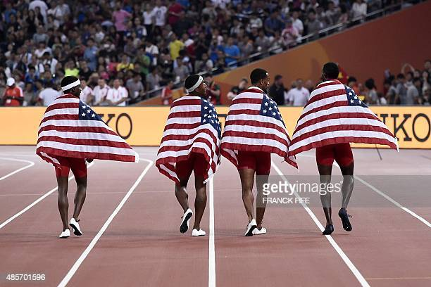 USA's 4x100 metres relay team USA's Trayvon Bromell USA's Tyson Gay USA's Justin Gatlin and USA's Mike Rodgers walk with national flags after...